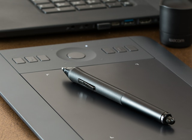 black wacom tablet with pen ontop