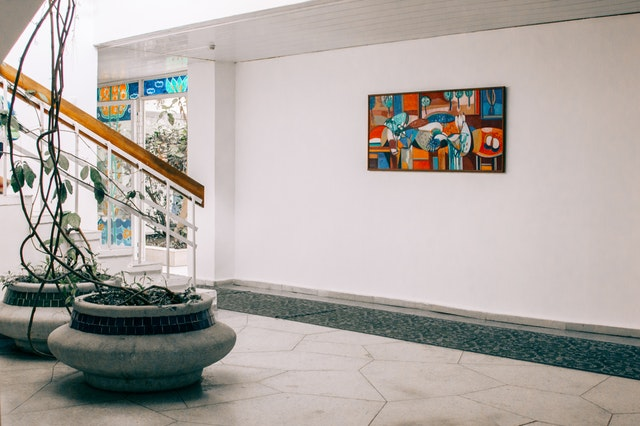 abstract painting on wall in front of staircase